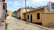 The Calle Madia Luna street in the center of the old town in Trinidad Cuba