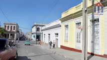 View into the street. At the end the Paseo of Cienfuegos leads along