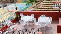 "The rooftop terrace of the ""Hostal Siglo XV"" in Trinidad, Cuba"