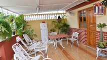 In the front of the rooms for rent you have the spacious terrace of the place