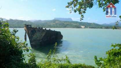 "Bay of Baracoa with views to ""El Yunque"" mountain"